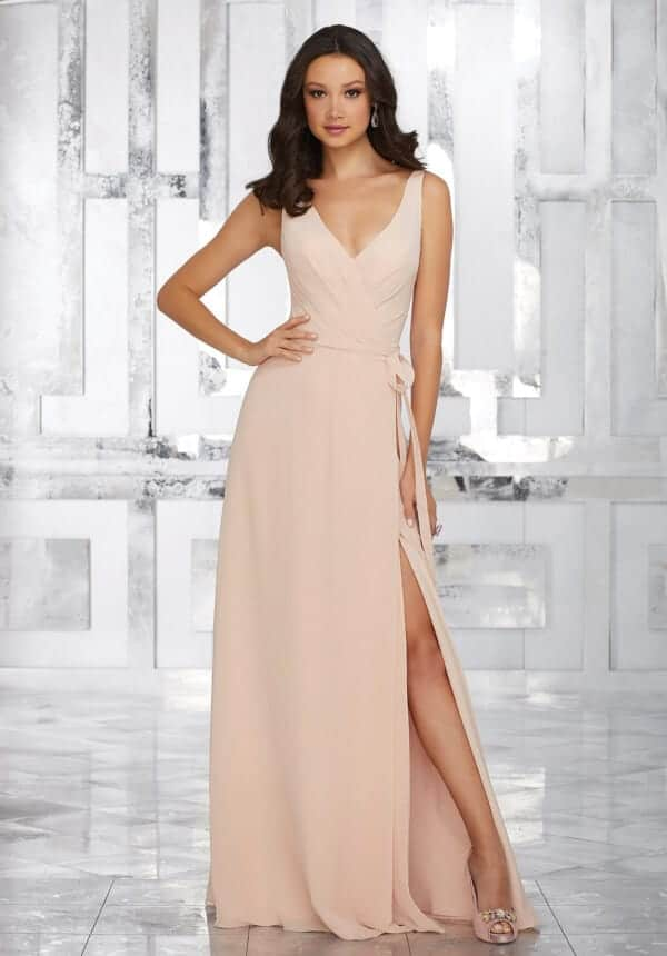 Mori Lee bridesmaid dress style number 21532. Sleeveless A-Line Chiffon Bridesmaids Dress Features a V Neckline and Asymmetrical Draping Along the Natural Waist. Shown in Blush.