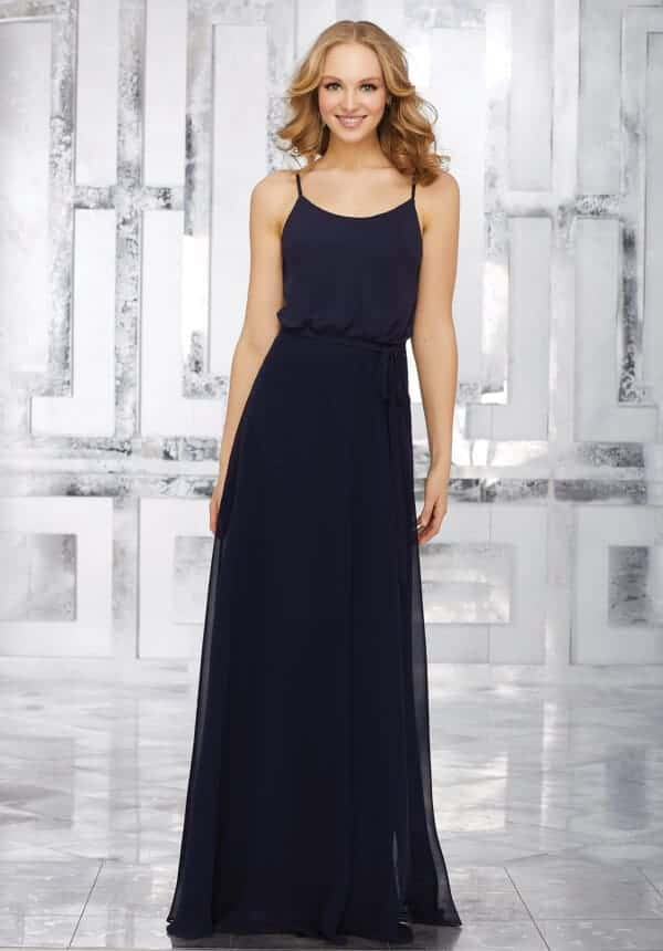 Mori Lee bridesmaid dress style number 21536. Chiffon Bridesmaids Dress Featuring a Scoop Neckline and Matching Tie Sash. Shown in Navy.