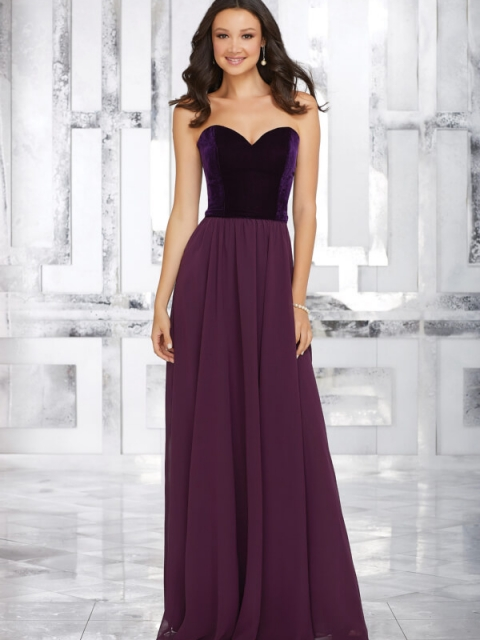 Mori Lee bridesmaid style number 21540.  Stretch Velvet Bodice and Flowy Chiffon Skirt Perfectly Compliment Each Other on This Full Length Bridesmaids Dress. Shown in Plum.