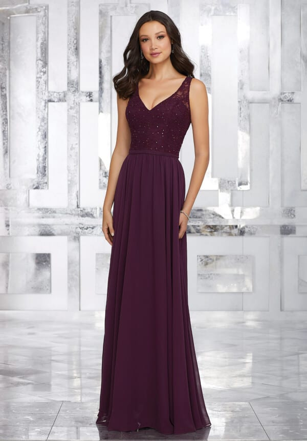 Mori Lee bridesmaid dress style number 21546.  Chiffon Bridesmaids Dress with Beaded Lace Bodice and Keyhole Back. Shown in Eggplant.