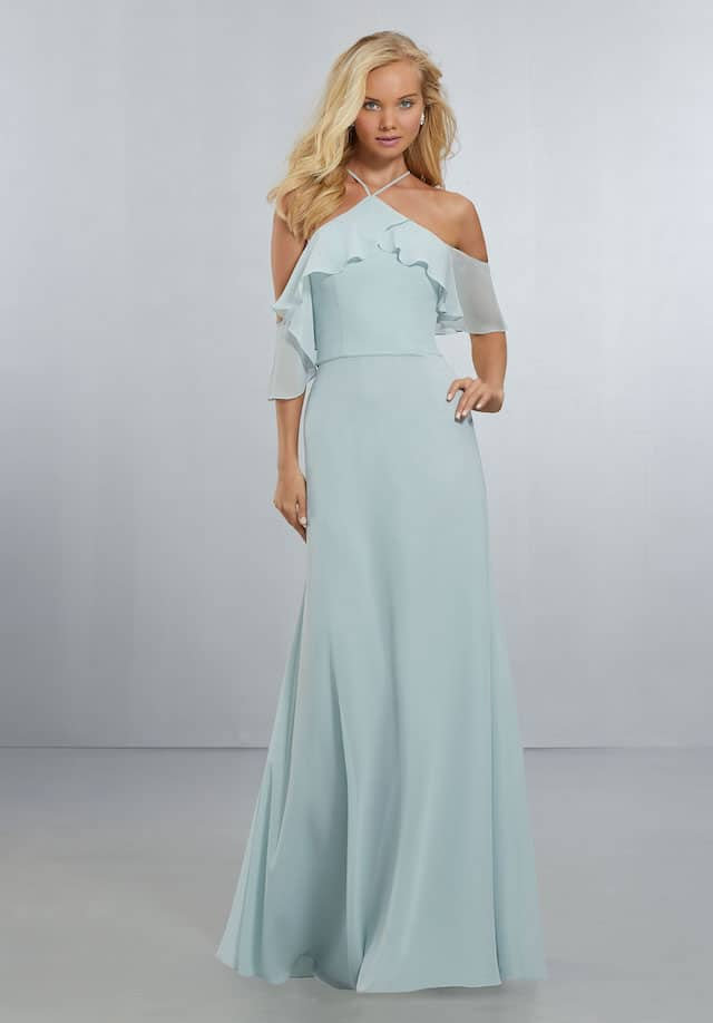 Mori Lee bridesmaid dress style number 21551. Flounced Halter Neckline with Cold-Shoulder Detail on a Flowing, A-Line Chiffon Gown with Zipper Back. Shown in Sea Glass.
