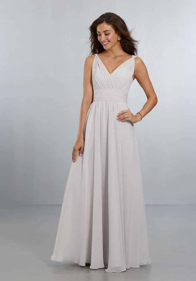 Mori Lee bridesmaid dress style number 21553. Classic, Full Chiffon A-Line Gown with Draped, Surplus V-Neckline and Waistline. The Twist Shoulder Detail Flows Down to the V-Back Neckline and Zipper Back. Shown in Dew Drop.