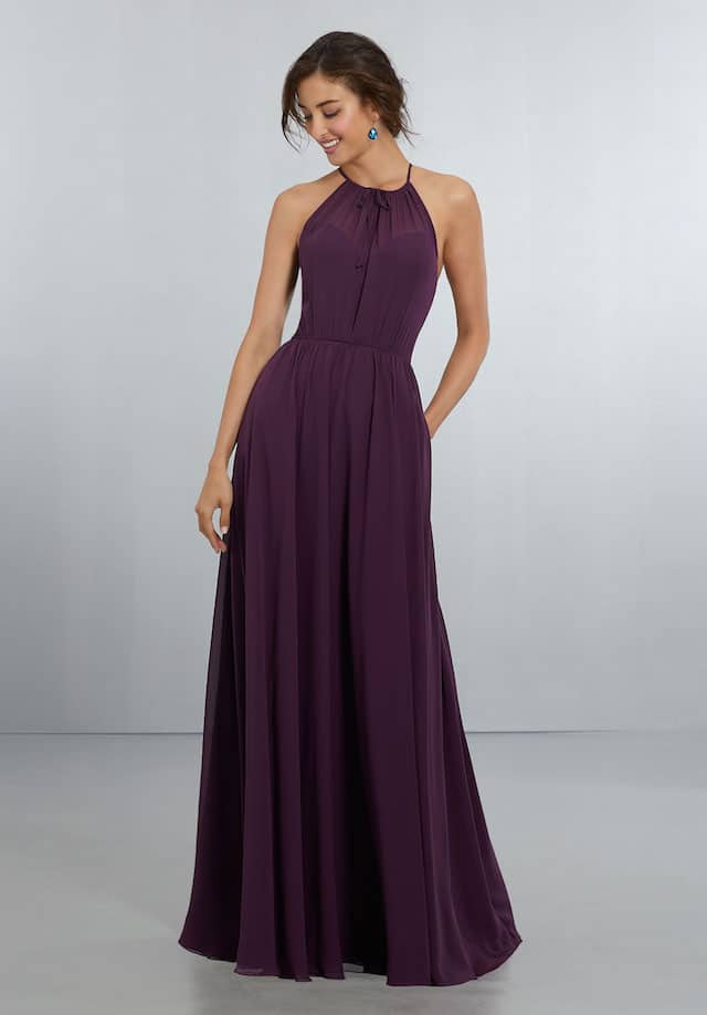 Mori Lee bridesmaid dress style number 21572. High Halter Chiffon A-Line Gown with Tie-Front Detail at the Neckline and Crystal Button Back Neckline Detail with Keyhole and Zipper. Shown in Eggplant.