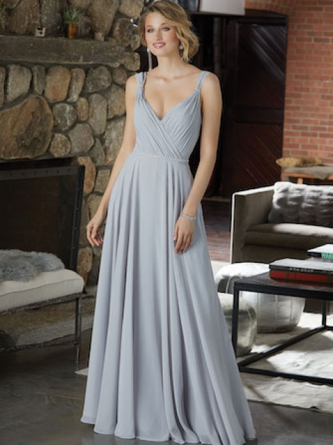 Chiffon Bridesmaid Dress Featuring a Figure Flattering A-Line Silhouette and Asymmetrically Draped Bodice. Beaded Shoulder Straps and a Delicately Beaded Waistline Complete the Look. Shown in Silver.