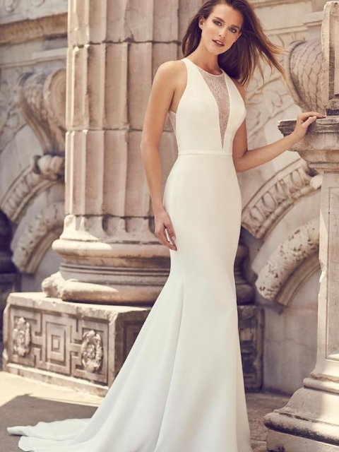 plain crepe fitted wedding gown with plunging neckline, lace insert and lace illusion back with covered button details, Canadian made Mikaella Bridal under $2600