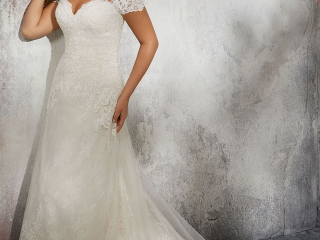 The Laverna by Morilee Madeline Gardner is a timeless Chantilly lace bridal gown that is accented with frosted Alençon Lace Appliqués. The off-the-shoulder cap sleeves add a romantic touch and are detachable. Call Runway Bridal in Belleville, Ontario at 613-966-0122 to book your appointment!