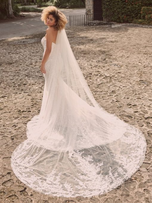 Off-the-shoulder nature-inspired bridal gown with flirty floral motifs at Runway Bridal
