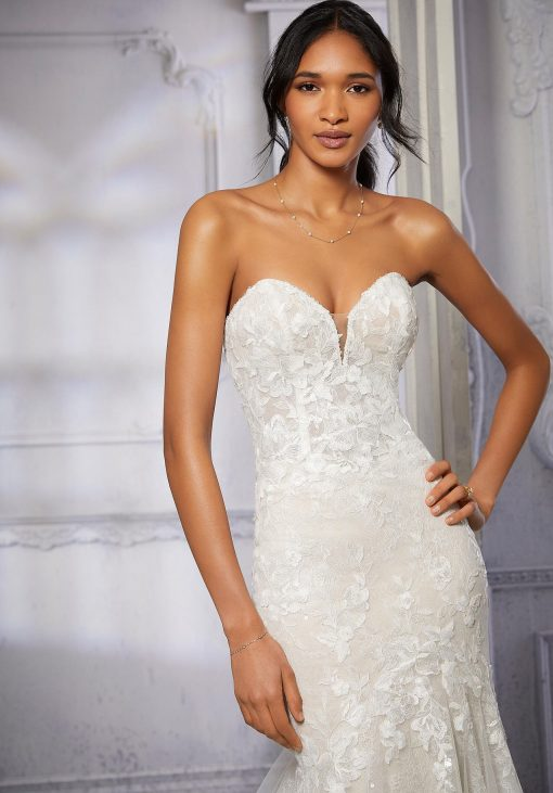 Lace off the shoulder wedding dress by Morilee