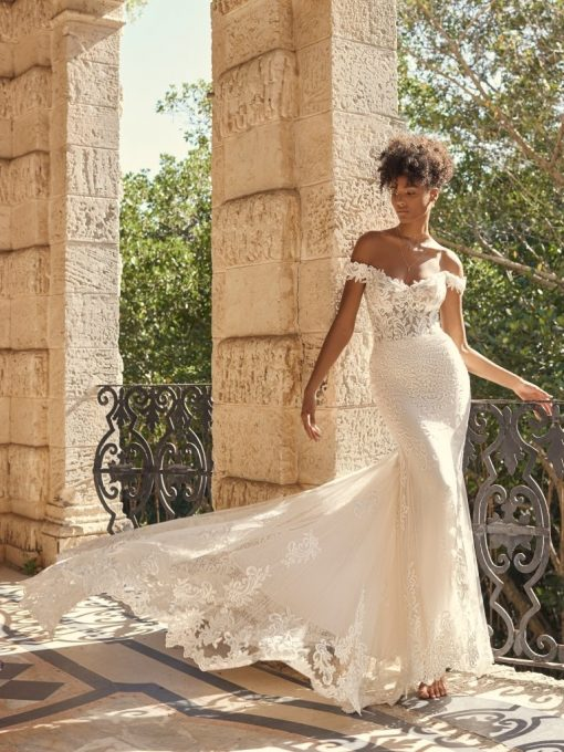 Romantic lace wedding gown with illusion train by Maggie Sottero